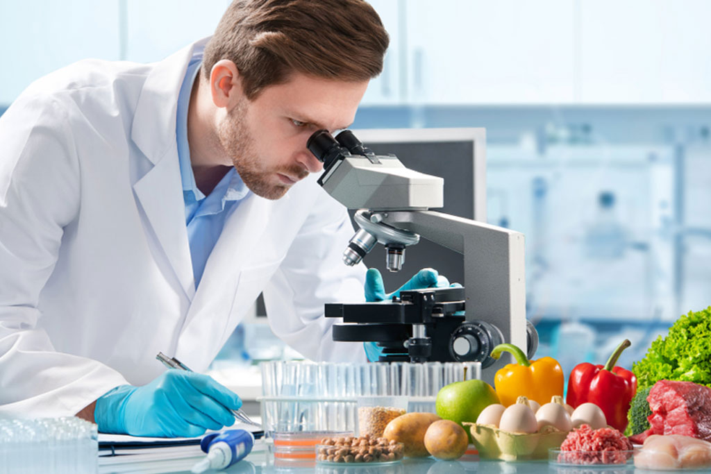 Biologist looking at food with a microscope ESMH Press Review 2019 August 7