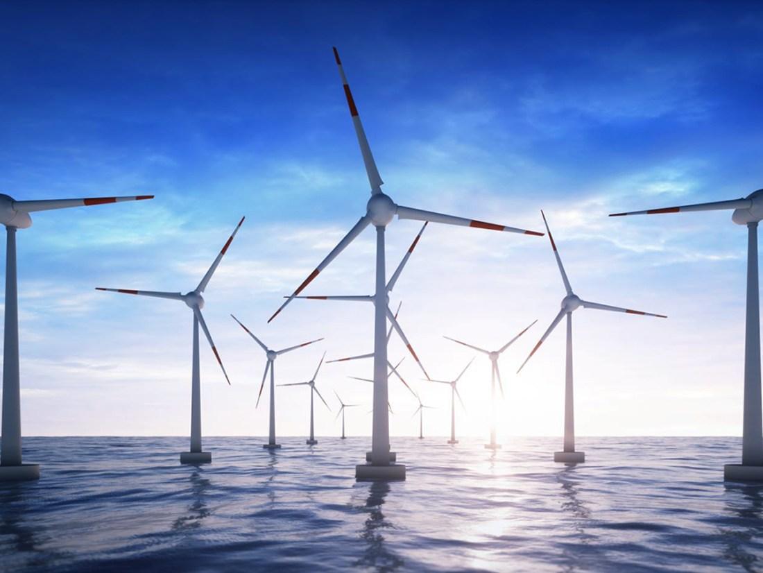 Wind farm in the ocean in sunset
