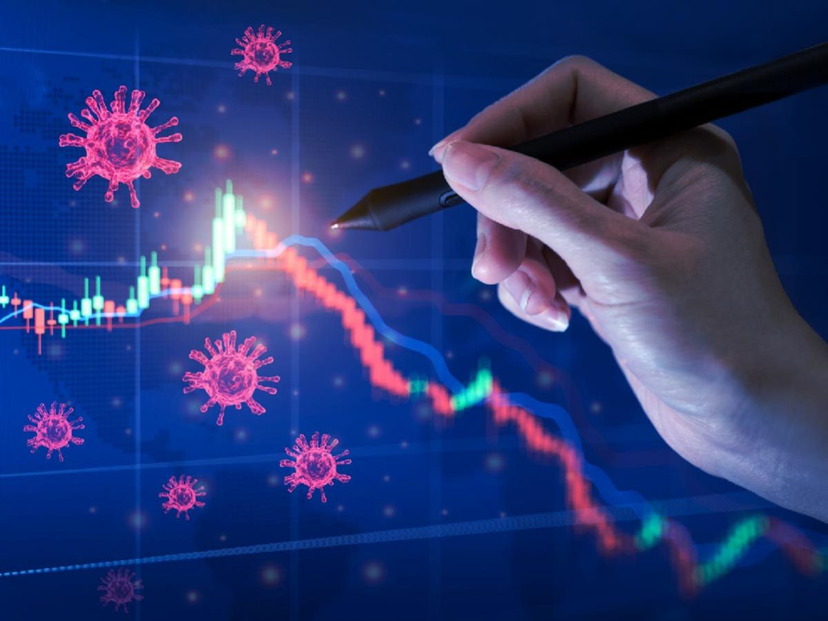 Coronavirus impact global economy stock markets financial crisis concept, Hand s' businessman show coronavirus or covid-19 sinks the global stock exchanges. Graphs representing stock