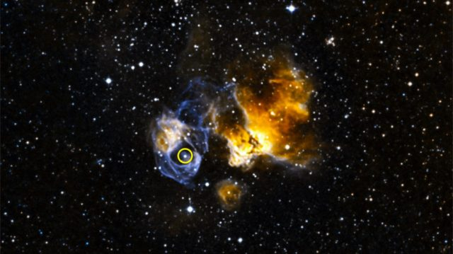 LMC P3 (circled) is located in a supernova remnant called DEM L241 in the Large Magellanic Cloud, a small galaxy about 163,000 light-years away. The system is the first gamma-ray binary discovered in another galaxy and is the most luminous known in gamma rays, X-rays, radio waves and visible light. Unlabeled image Credit: NOAO/CTIO/MCELS, DSS