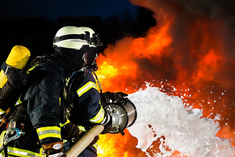 firefighters using foam