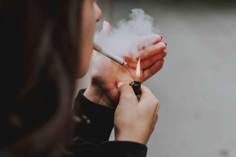 person smoking cigarette