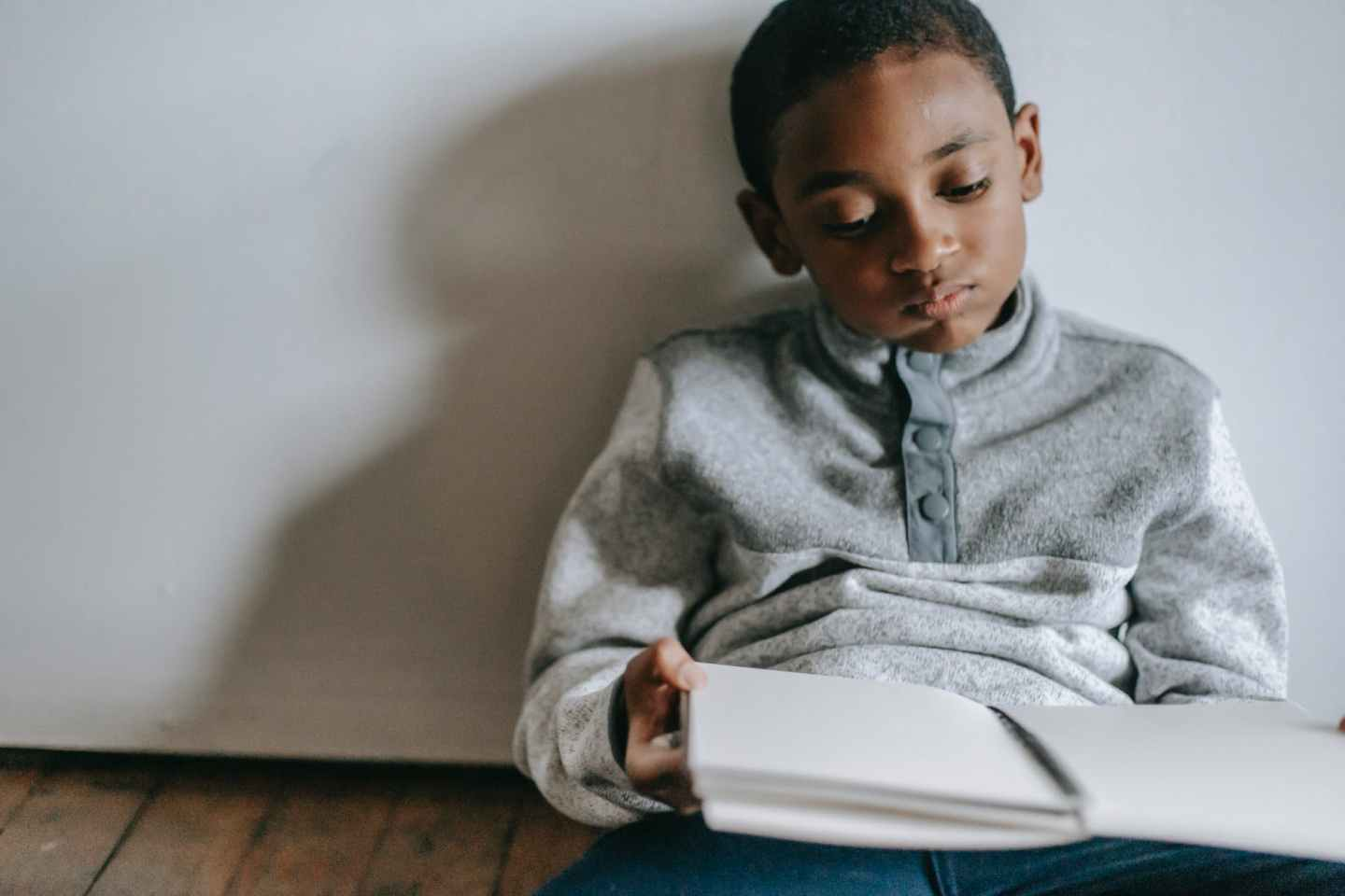 thoughtful black boy with copybook