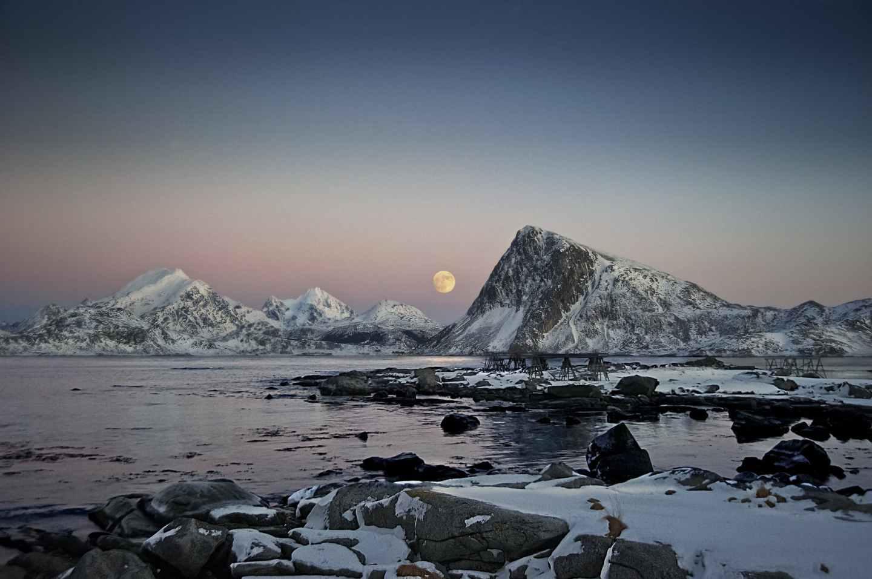 rocky mountain near body of water