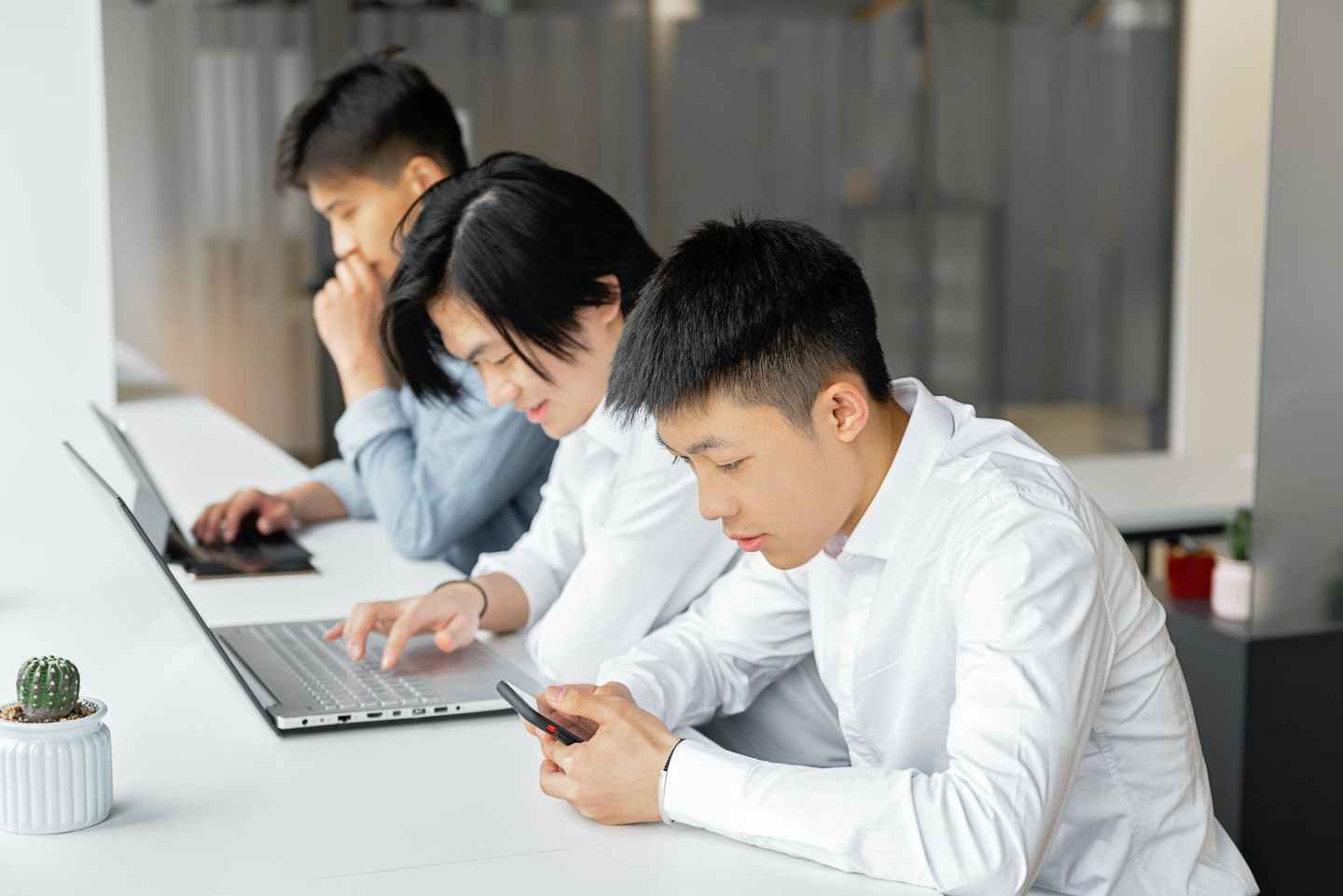 men working modern using electronic devices
