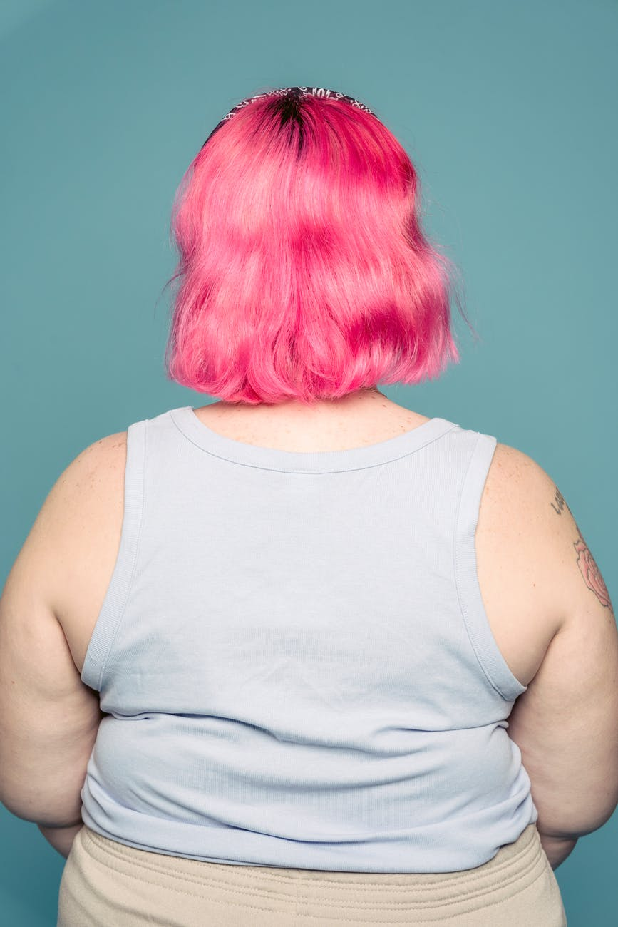 woman with pink hair in studio