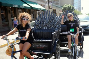 Pedicab cyclists pose with their Game of Thrones-themed cabs