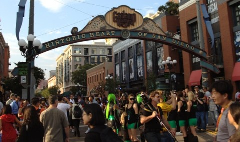Crowds throng the streets of the San Diego Gaslamp District