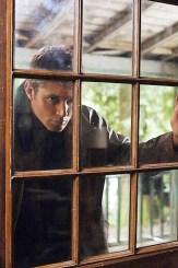 Dean knocks on a door.