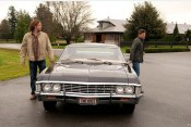 Sam and Dean emerge from the Impala.