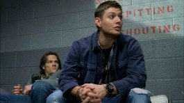 Dean sasses to his captors while in jail.
