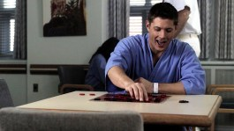 Dean plays a game of checkers with himself.