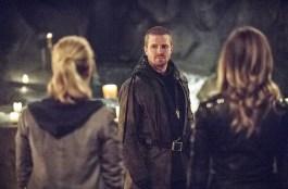Oliver looks gazes sadly at Felicity and Laurel.