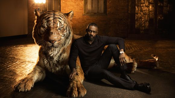 Idris Elba the voice of Shere Khan with the CGI tiger himself. Credit: usatoday.com