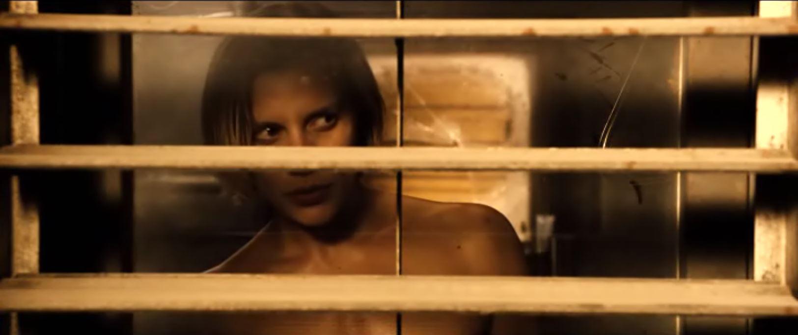 Katee Sackhoff standing topless in Riddick