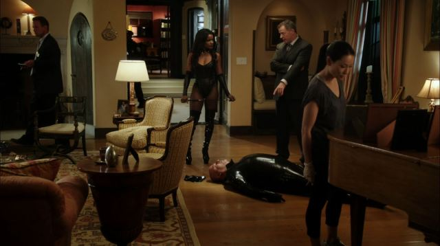 Elementary - Poison Pen - Woman in latex catsuit with Gregson and Watson