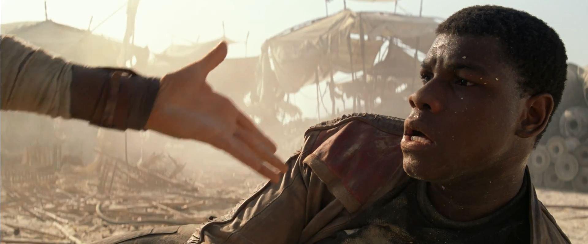 John Boyega as Finn getting a hand. New Star Wars The Force Awakens Trailer Released!