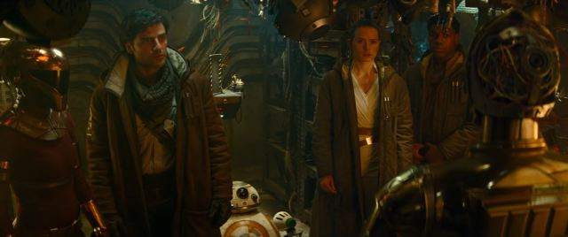 Poe Rey Finn and BB-8 watch C3PO in The Rise of Skywalker
