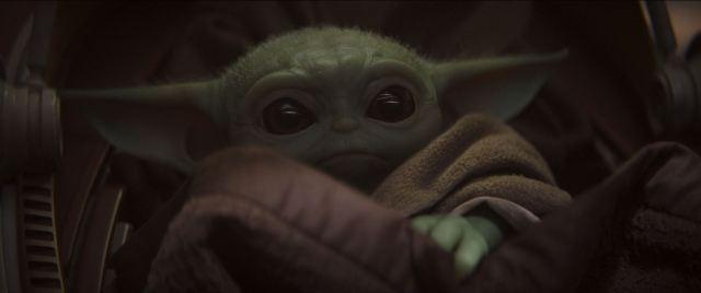 The Mandalorian with baby Yoda