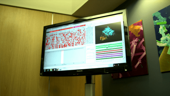 A screen grab from Contagion (2011), showing a display for a virologist, including gene sequences, and spectroscopy.
