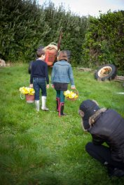Tamara sets up a close-up shot of the kids carrying buckets of narcissi