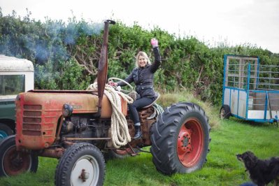 Tamara hitching a ride on Ben and Caroline Gillett's tractor