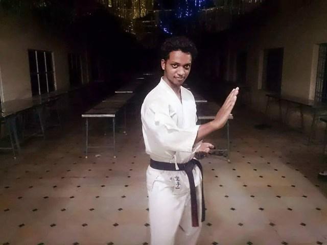 Amit posing in Black Belt after positive affirmation meditation and mindfulness