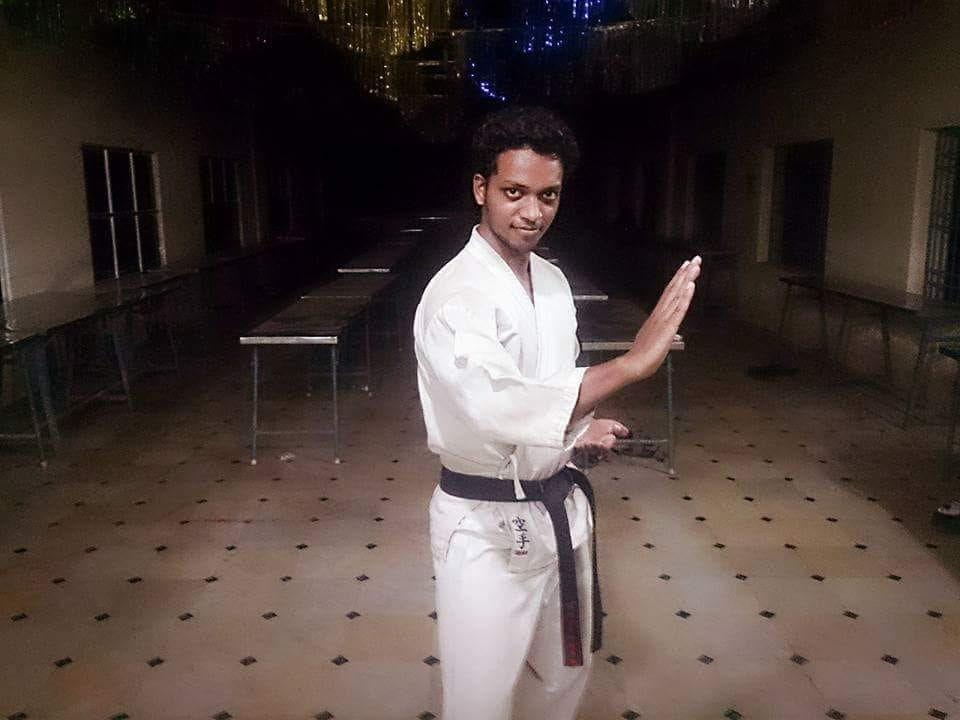 Amit posing in Black Belt after positive affirmation meditation and mindfulness
