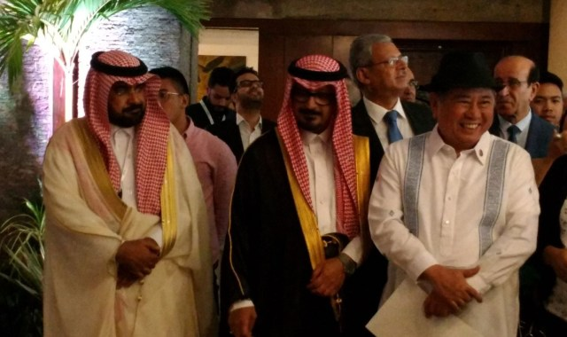 with-king-faisal-exec-and-ncca-chief.jpg