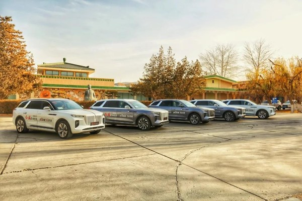 "A fleet of nine Hongqi E-HS9 wraps up ""Hongqi Journey"" after reaching Dunhuang, Gansu Province in northwest China, Dec. 30, 2020."