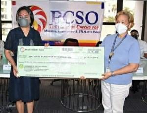 PCSO distributes checks.