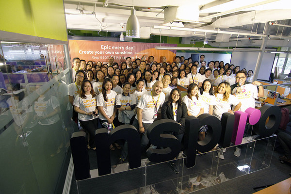 Management and employees celebrate the successful launch of the Inspiro brand