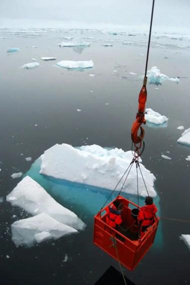 Scientists Sampling Under Ice Phytoplankton Communities