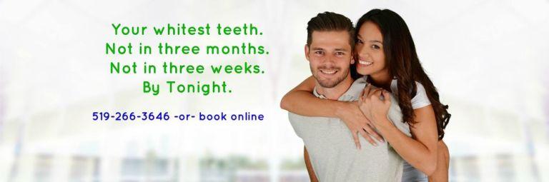 Man and Woman enjoying their white teeth.