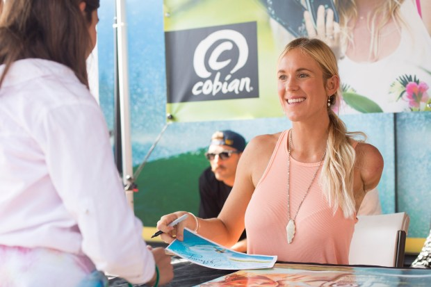 Shark attack survivor Bethany Hamilton signs an autograph for Isabella Hagopian during a meet and greet at Jack's Surfboards in 2016. (Photo by Drew A. Kelley, Contributing Photographer)