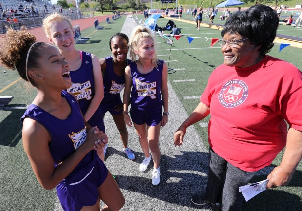 Members of the Woodcrest Christian's Girls 4x100 relay team talk with track and field legend Rosie Bonds during the Raincross Tradition/Riverside City Championship High School Track & Field meet at King High School in Riverside Saturday, Apr.15, 2017. FRANK BELLINO, THE PRESS-ENTERPRISE/SCNG