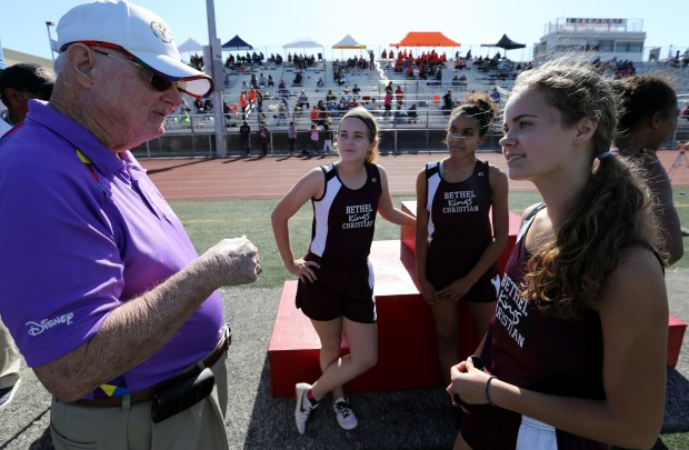 Track and field legend Paul Mahoney talks with Bethel Christian's Micaiah Brown and the members of the Girls 4x100 relay team during the Raincross Tradition/Riverside City Championship High School Track & Field meet at King High School in Riverside Saturday, Apr.15, 2017. FRANK BELLINO, THE PRESS-ENTERPRISE/SCNG
