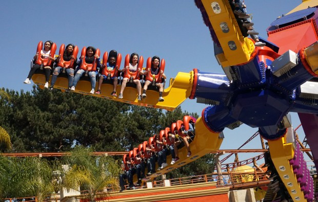 Riders on the new Sol Spin ride at Knott's Berry Farm. The thrill ride holds up to 36 riders at a time, six on each arm. It spins around, goes up in the air, and turns riders upside down. (Courtesy, Knott's Berry Farm)