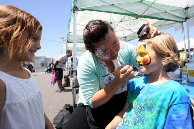 Gianna Pucella, 4, watches her friend Jonny Byer, 7, get face painted by Grace King from Kaman's Art Shoppes during the Earth Day Festival at the Bolsa Chica Interpretive Center in Huntington Beach on Saturday, April 22, 2017. (Photo by Ana P. Gutierrez-Garcia, Contributing Photographer)