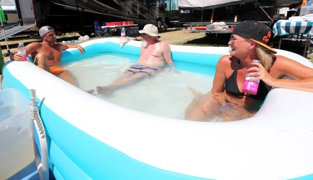 Country music fans cool off in a pool in the RV parking during the Stagecoach Country Music Festival at the Empire Polo Club in Indio Saturday, April 29, 2017. FRANK BELLINO, THE PRESS-ENTERPRISE/SCNG