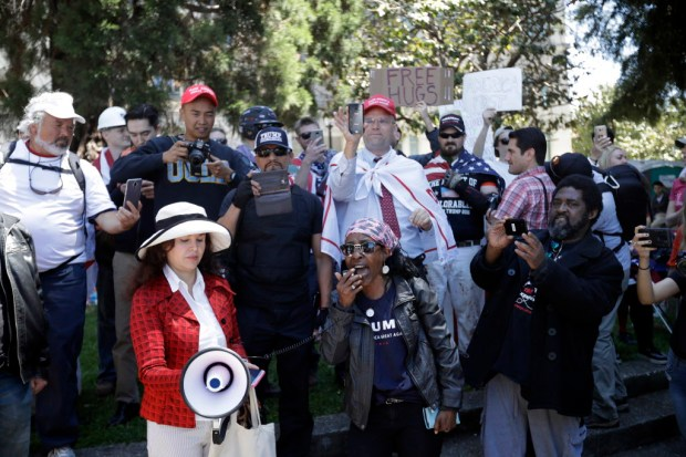 Demonstrators gather around a speaker Thursday, April 27, 2017, in Berkeley, Calif. Demonstrators gathered near the University of California, Berkeley campus amid a strong police presence and rallied to show support for free speech and condemn the views of Ann Coulter and her supporters. (AP Photo/Marcio Jose Sanchez) ORG XMIT: CAMS102