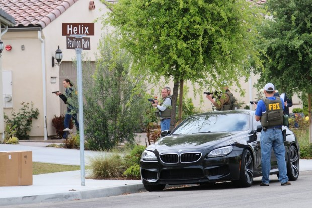 The FBI arrested a man at a home on Pavilion Park in Irvine on Thursday, April 13, on suspicion of using a fake website to defraud the parent company of Enterprise Rent-A-Car. He was later identified as Yi Liu, 28. (Photo courtesy of Bryan Ouchi)
