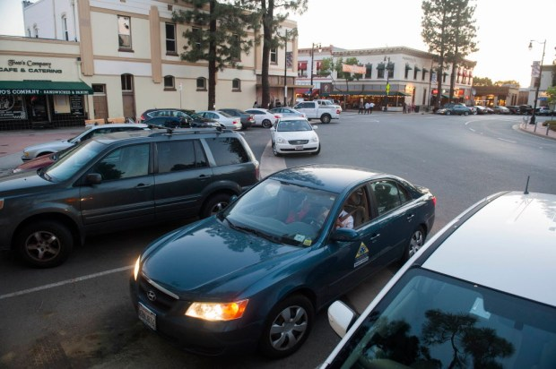 Eddie Alvarez, center in white car, waits patiently for a parking space in Old Towne Orange Wednesday night. ///ADDITIONAL INFO: parking.0329.kjs --- Photo by KEVIN SULLIVAN / Orange County Register -- 3/25/15 The worst places to park in Orange County - Old Towne Orange 3/25/15
