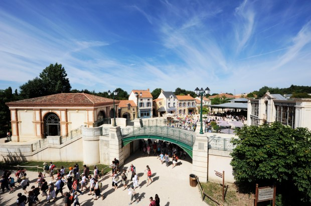 Visitors enter one of the themed villages at Puy de Fou theme park in France. The villages are meant to immerse visitors into historic eras from the past of France. (Photo courtesy: Puy de Fou)