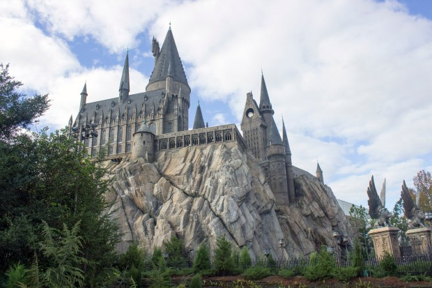 """Hogwarts Castle at the Wizarding World of Harry Potter in Universal's Islands of Adventure in Orlando houses the ride """"Harry Potter and the Forbidden Journey) and opened there in 2010. At its base sits Hogsmeade, the village in the """"Harry Potter"""" movies where visitors can purchase wands and cause magic to take place. (Photo by: Mark Eades, Orange County Register/SCNG)"""