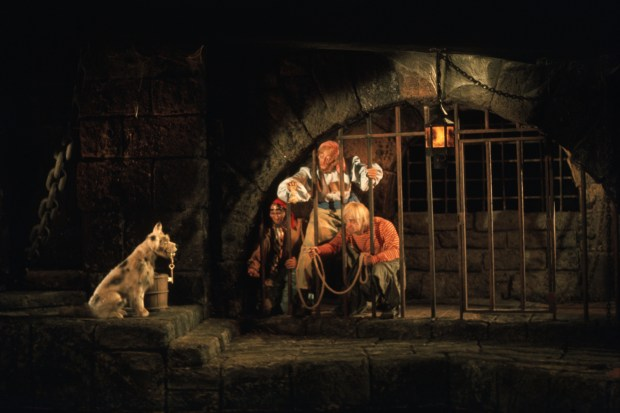 This scene in the Pirates of the Caribbean attraction is in Adventureland at the Magic Kingdom of Walt Disney World. This scene is the same as the one at Disneyland where pirates stuck in jail are trying to entice the dog to give them the key to the jail cell so they can escape. (Courtesy: The Walt Disney World Resort)