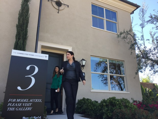 Brookfield Residential officials walk out of the company's model home at the Delano community of Irvine's Eastwood Village on May 3, 2017. The homes in the developing community will be the first in the nation to have Apple's HomeKit technology built-in as standard. (Photo by Tomoya Shimura, Orange County Register/SCNG)