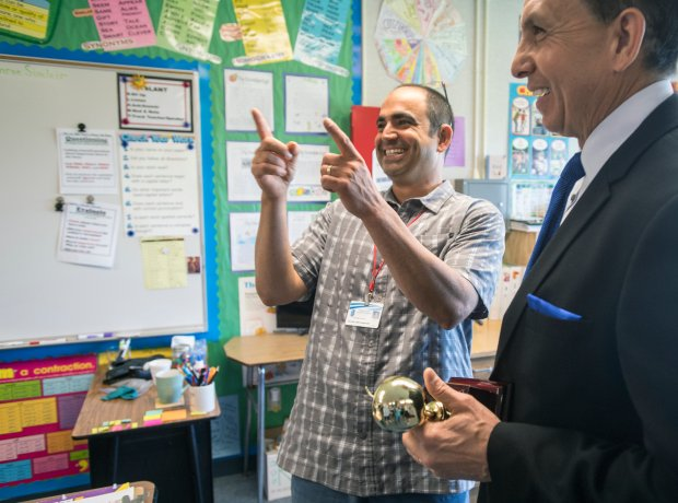Vincent Saporito reacts after he was surprised with a 2018 Teacher of the Year award from the Orange County Department of Education in Huntington Beach, California, on Tuesday, May 2, 2017. Saporito, is a special education teacher for the deaf and hard of hearing at College View Elementary School, is one of six teachers who were surprised with the honor by county superintendent of school Dr. Al Mijares. (Photo by Jeff Gritchen, Orange County Register/SCNG)