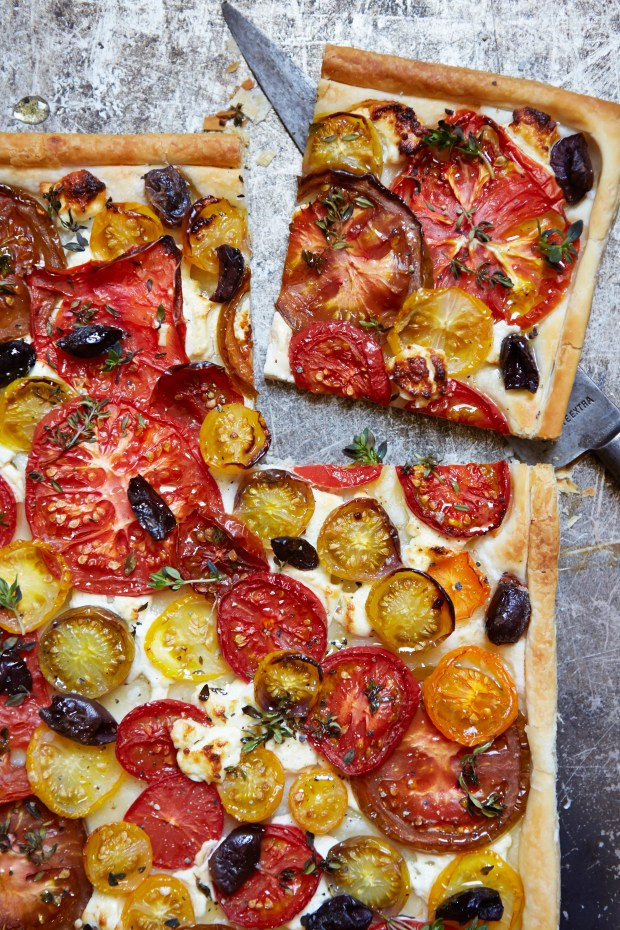 "John Whaite, a winner of ""The Great British Baking Show,"" brings five ingredients together in this tomato tart. (Photo by Helen Cathcart)"