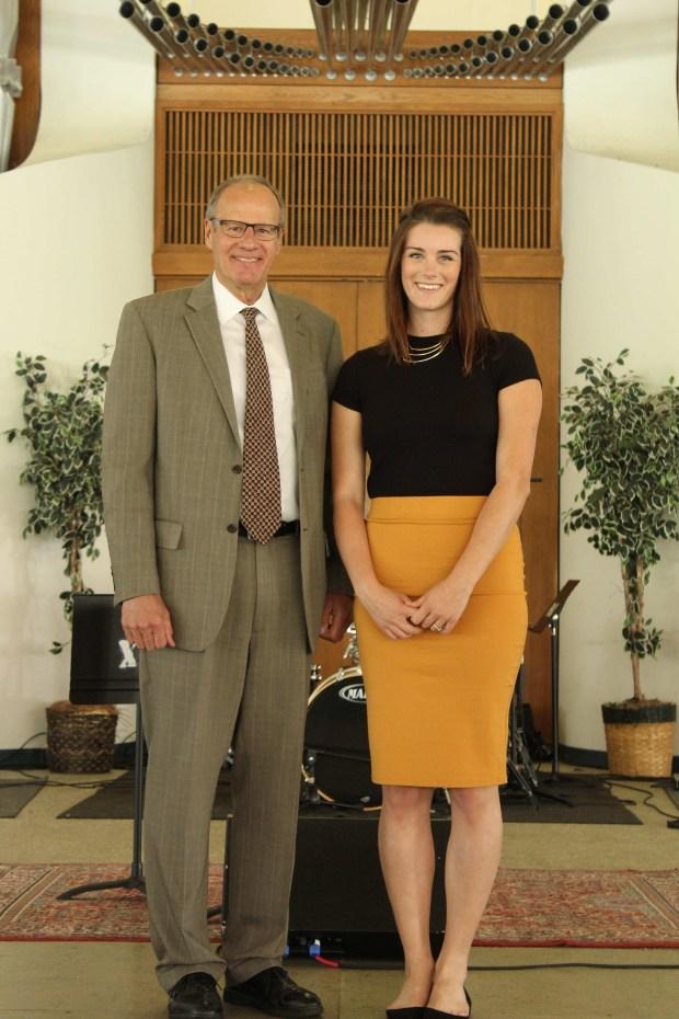 Concordia University Irvine senior Emily English poses for a photo with Concordia president Kurt Krueger. (Courtesy of Concordia University Irvine)